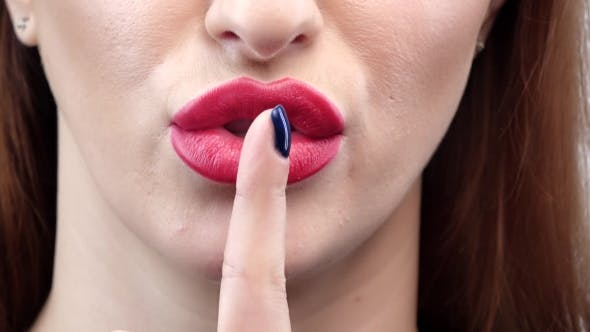 Thumbnail for Woman Lips with Finger Asking for Silence