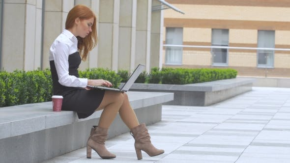 Thumbnail for Redhead Woman Using Laptop with a Cup of Coffee on the Terrace