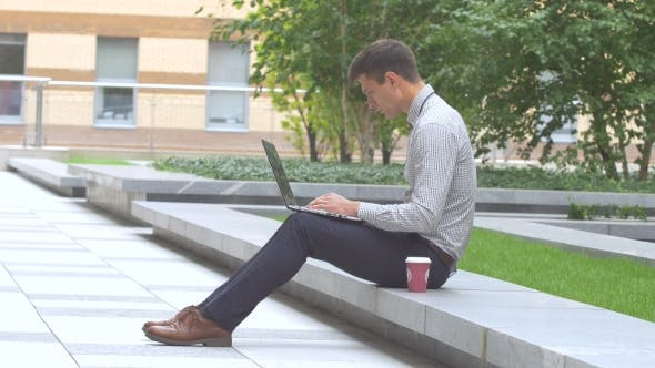 Thumbnail for Stylish Man Working on Laptop Outdoors, Terrace, Cup of Coffee