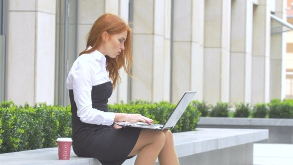 Thumbnail for Business Woman Using Laptop with a Cup of Coffee on the Terrace
