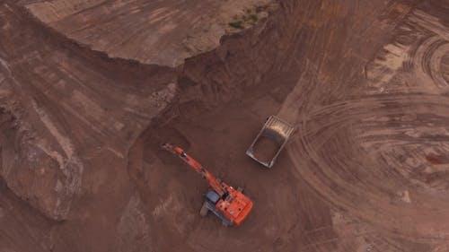 Loading Sand Excavating in Heavy Trucks
