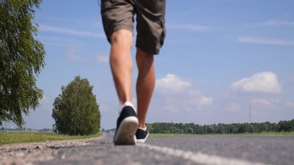 Thumbnail for Young Man Walking on a Countryside Road. .