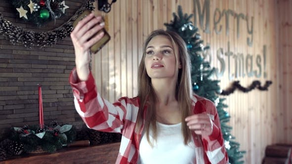 Thumbnail for Woman Doing Selfie Against Christmas Decor