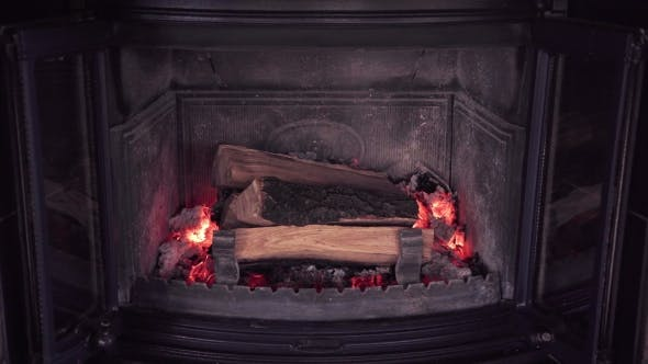 Thumbnail for Log Pieces Burn in Fireplace