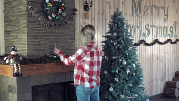 Thumbnail for Woman Decorating Fireplace for Christmas