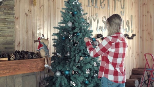 Cover Image for Woman Putting Balls at Christmas Tree