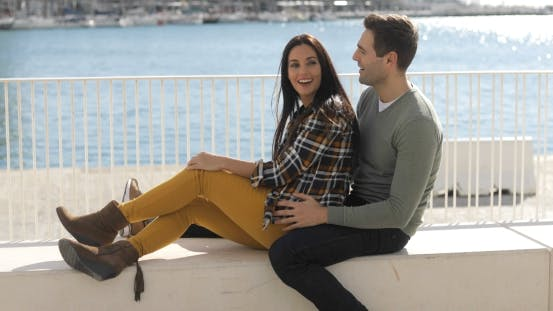 Thumbnail for Loving Young Couple Relaxing at the Waterfront