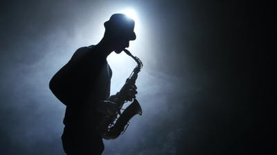 Solo Concert of the Actor Playing on the Saxophone. Smoke