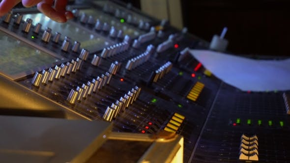 Thumbnail for Sound Technician Adjusts a Music Mixer