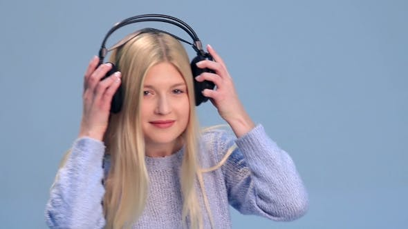 Thumbnail for Charming Girl with Headphones Listening To Music