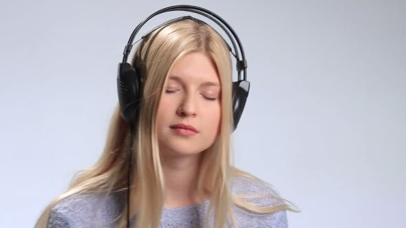 Thumbnail for Beautiful Girl with Headphones Enjoying Music