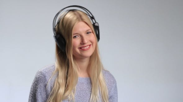 Thumbnail for Teenage Girl Wearing Headphones Listens To Music