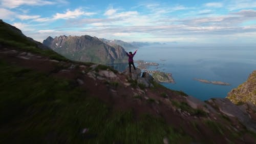 Hiker Woman Standing with Hands Up Achieving the Top