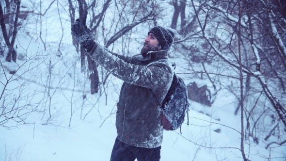 Thumbnail for Bearded Man Making Selfie in Snowy Wood