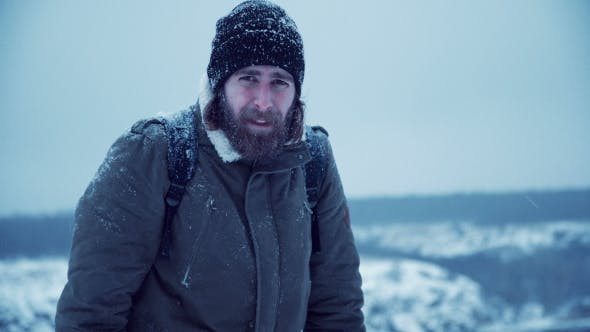 Thumbnail for Serious Man with Beard in Snow