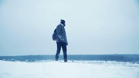Man Wandering Outdoors in Winter
