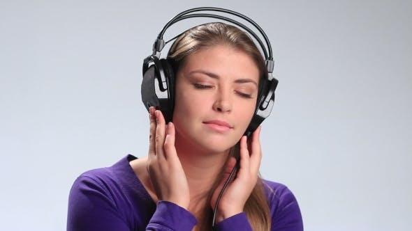 Thumbnail for Calm Brunette Woman Enjoying Music in Headphones