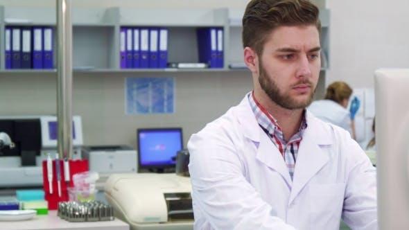 Thumbnail for Man Looks at the Monitor at the Laboratory