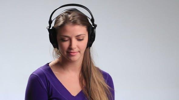 Thumbnail for Expressive Girl in Headphones Enjoying Music