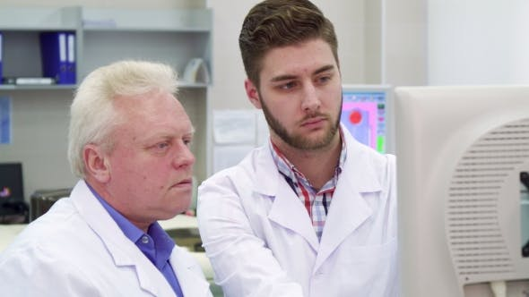Thumbnail for Man Points His Hand on Monitor at the Laboratory