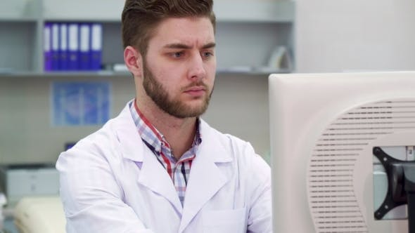 Thumbnail for Man Uses Computer at the Laboratory