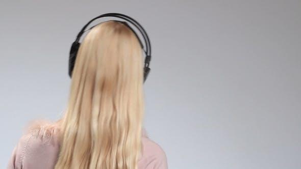Thumbnail for Emotional Girl in Headphones Listening Music