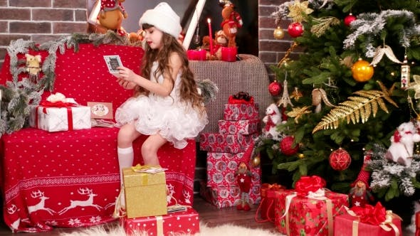 Thumbnail for Little Girl Lays Out the Name Cards on Christmas Gifts