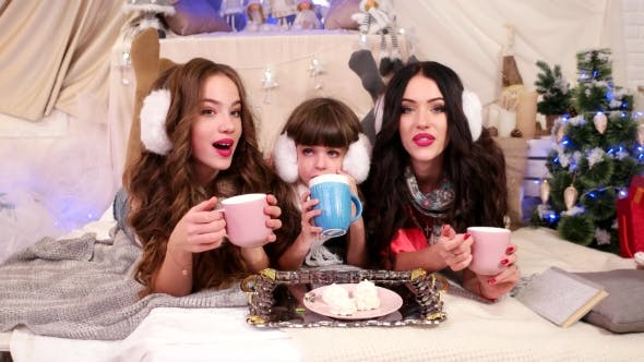 Cover Image for Children Drink Tea, Three Sisters Different Ages Spend Time Together, Talking, Laughing, Enjoying