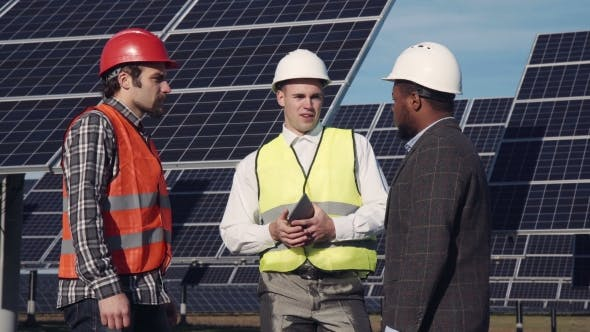 Thumbnail for Solar Panel Workers and Manager Outside