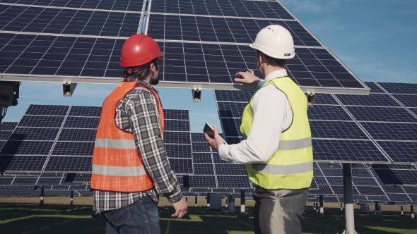 Thumbnail for Technicians Discussing Solar Panel Array Outside
