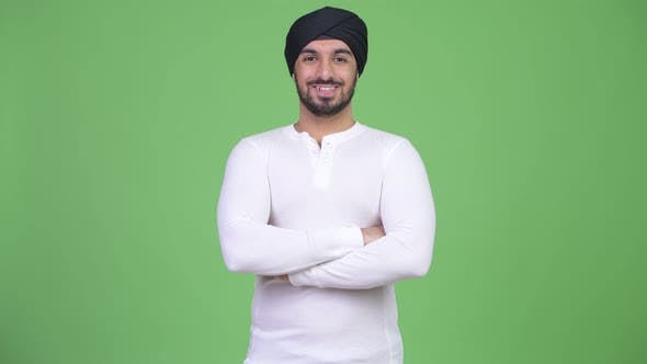 Thumbnail for Young Happy Bearded Indian Man with Arms Crossed