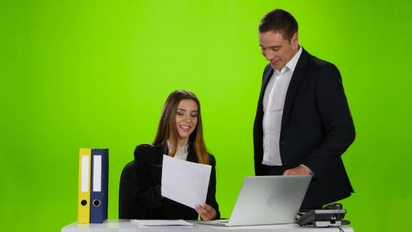 Thumbnail for Office Workers Laughing at the Seen a Mistake in Document