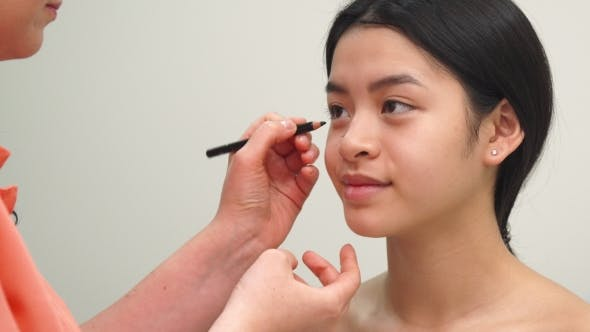 Thumbnail for Beauty Specialist Uses Cosmetic Pencil