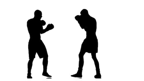 Forbidden Low Blow in Boxing. Silhouette