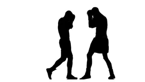 Muscular Boxers Are Trained To Hit an Opponent