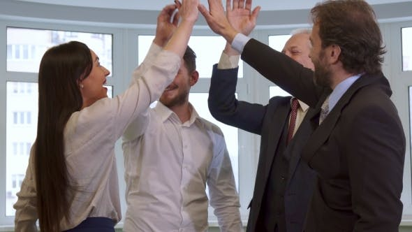 Thumbnail for Business People Hihg-fiving at the Office
