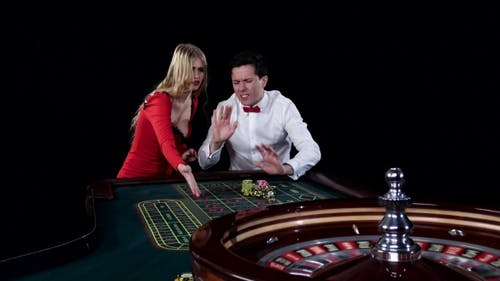 Couple Playing Roulette Is Eager To Win at the Gambling House