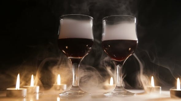 Thumbnail for Wine Glasses and Burning Candles in the Smoke