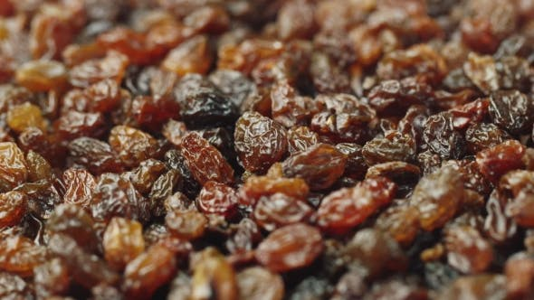Thumbnail for Background of Food - Rotating Raisins. Sweet Food and Dried Fruits
