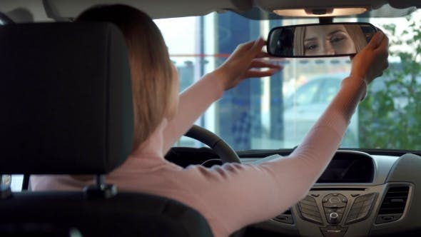 Thumbnail for Girl Looks Into the Rear-view Mirror