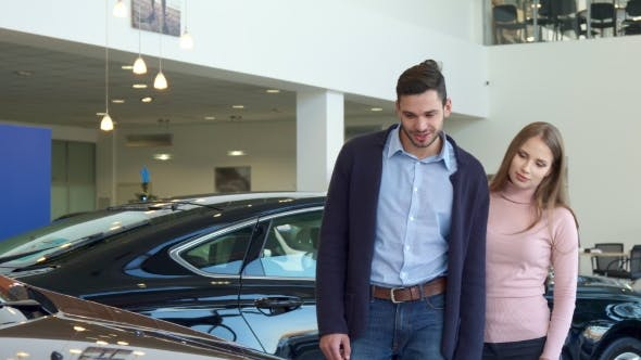 Thumbnail for Young Couple Chooses Car at the Dealership