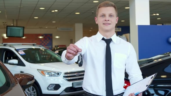 Thumbnail for Sales Manager Shows Car Key at the Dealership
