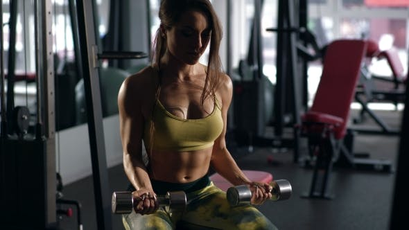 Thumbnail for Woman Doing Exercise on the Biceps with Dumbbells on the Bench