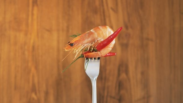 Thumbnail for Rotating Fork With Prawn and Chili Pepper on Wooden Background