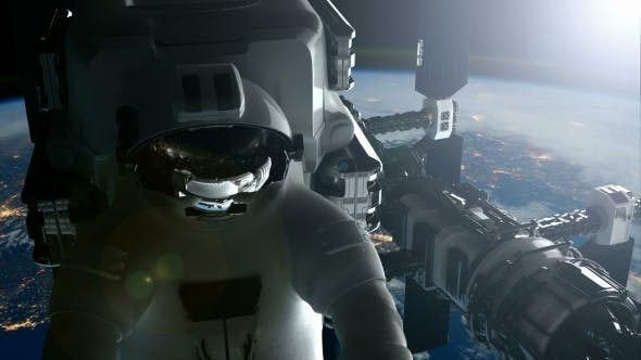 Thumbnail for International Space Station and Astronaut Orbiting Earth