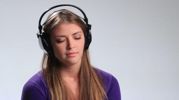 Thumbnail for Enjoying Her Favorite Music in Earphones