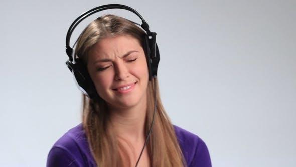 Thumbnail for Excited Brunette Girl in Headphones Enjoying Music