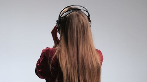 Party Woman with Headphones Listening To Music