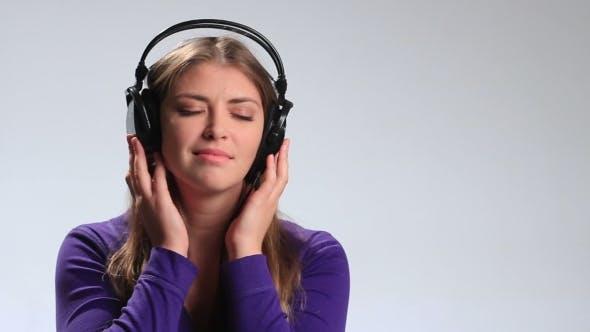 Thumbnail for Young Beautiful Woman Enjoying Music in Earphones