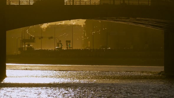 Thumbnail for Beautiful View of the Seafront in the Mist, Which Going Cars with Lights at Sunset. Saint-Petersburg
